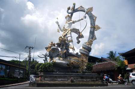 BALI, INDONESIA - MARCH 22 : Art sculpture and carved antique deity angel god of hindu statue balinese style on roundabout building traffic road at Ubud town city on March 22, 2018 in Bali, Indonesia Editorial