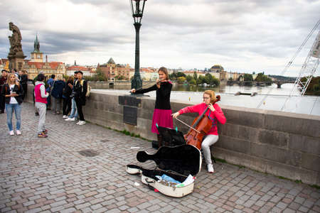 Music band of Czech women musician people playing music instrument violin and Violoncello or Cello for show people and travelers on Charles Bridge  on September 225, 2019 Prague, Czech Republic