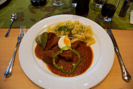 Dinner main course fusion austrian style serve to customer and travelers eat drinks in dining room of restaurants in Obergurgl village Solden valley at Otztal Alps in Tyrol, Austria