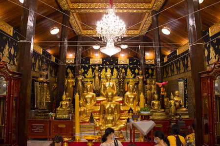 Thai people and foreign traveler respect praying and rite ritual god angel buddha statue at Wat Bang Phli Yai Nai Temple in Bang Phli Yai at Bang Phli city on July 12, 2020 in Samut Prakan, Thailand