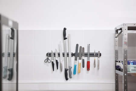 Kitchen tools hanging neatly on the wall