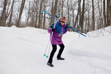 Portrait of a senior skier in a winter forest