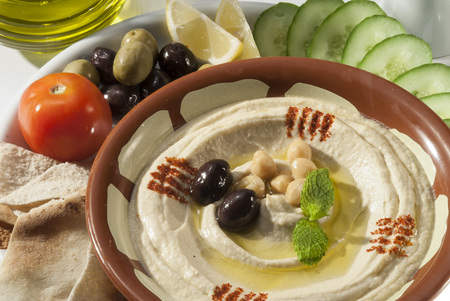 Hummus with khubz and olive with fresh vegetable salad