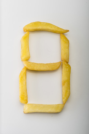 Number 8 formed by french fries Stock Photo