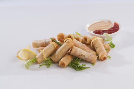 dipping: Fried spring rolls Stock Photo