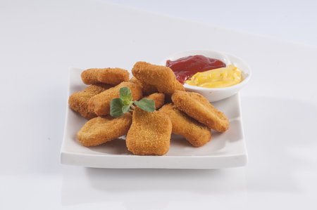 dipping: Fried nuggets Stock Photo