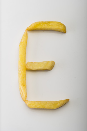 Alphabet E formed by french fries Stock Photo