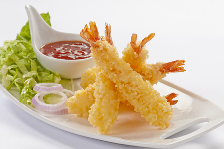 Tempura Jumbo Shrimps with salad and salsa dip on white plate and white background