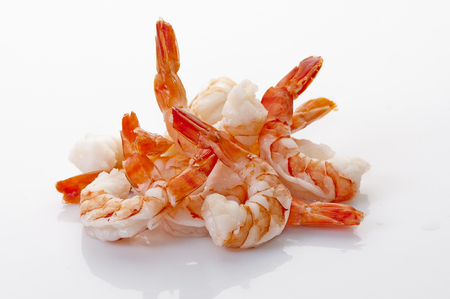 Jumbo Head Less Cooked prawns on white plate on white background