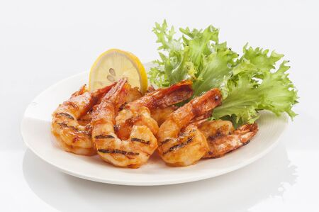 Grilled Jumbo headless shrimp with tikka marinade with lemon tomato and lettuce
