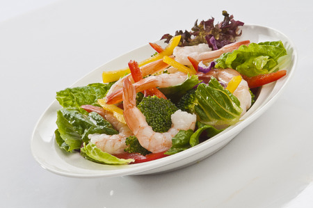 Jumbo Shrimp Salad with broccoli & Vegetable with coloured bell pepper on white plate with white background