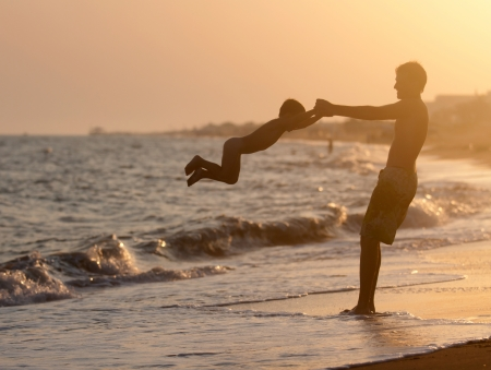 family beach: Father and son playing on beach