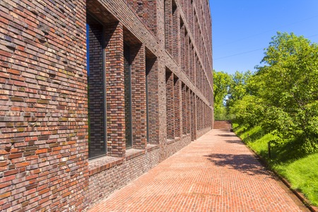 Office building made of brick with large Windows. Decorative masonry using curves, non-standard bricks.