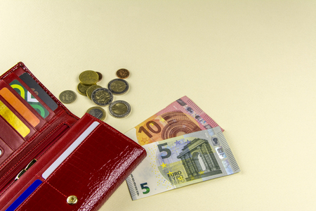 Red woman wallet. Banknotes ten and five euros. A few coins. Zdjęcie Seryjne