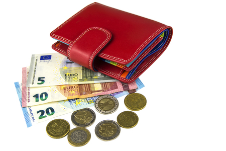 Isolate on white background. EU cash. Banknotes of 5, 10, 20 euros. Some coins. Womans red wallet Stock Photo