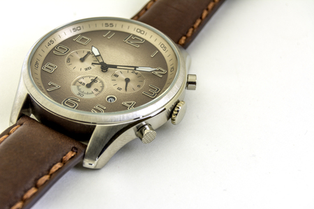 Isolated. Close up. Mens watches with brown strap are on a white background. Stock Photo