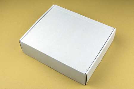 Cardboard box on beige background. Packing box in stock.