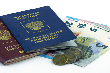 Russian documents. Residence permit and russian passport. Cash Euro banknotes on white background. Close up