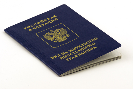 Russian documents. Residence permit on white background. Close up