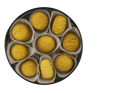 Cookies in paper baskets and in a big box. Top view. Isolated Stok Fotoğraf