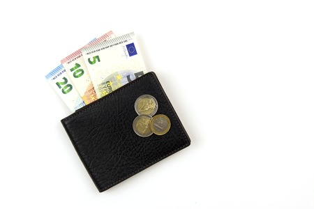 Euro banknotes in black mens purse. A few Euro coins. On white. Reklamní fotografie