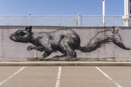 Moscow, Russia, 29 apr 2019. Graffiti in the Parking lot. Big rat. Fallen off plaster Editorial