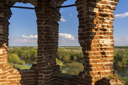 Bell tower inside the ruined Church in Russia. River view. Kolentsy, Ryazan.