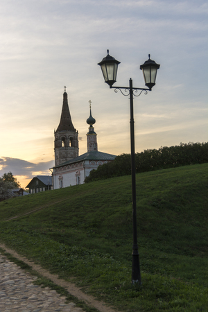 Evening in Suzdal, Russia. Old-fashioned lantern and cobbled street and Church