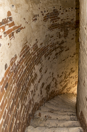 Old brick spiral staircase in the bell tower. View down