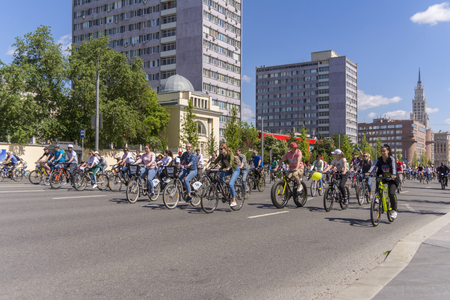 Moscow. Russia. 19 may 2019. Moscow Cycling festival 2019. Numerous cyclists ride along a wide street in a row.