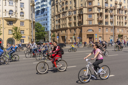 Moscow. Russia. 19 may 2019. Moscow Cycling festival 2019. Many cyclists ride along the wide street. Editorial