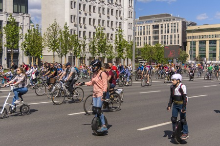 Moscow. Russia. 19 may 2019. Moscow Cycling festival 2019. People on gyrometer on the parade Editorial