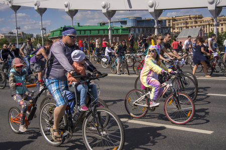 Moscow. Russia. 19 may 2019. Moscow Cycling festival 2019. The father goes with his daughters on a speculative Bicycle