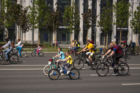 Moscow. Russia. 19 may 2019. Moscow Cycling festival 2019. Happy young cyclists, a boy and a girl ride together