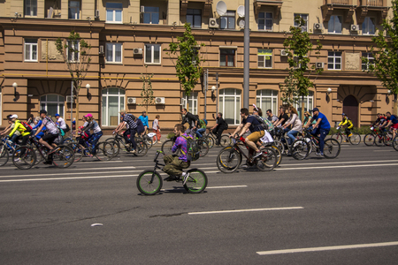 Moscow. Russia. 19 may 2019. Moscow Cycling festival 2019. Cyclist during the trip takes the camera. Editorial