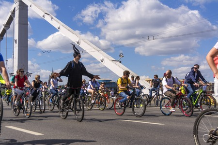 Moscow. Russia. 19 may 2019. Moscow Cycling festival Velofest 2019. Funny bike lovers go on the bridge.