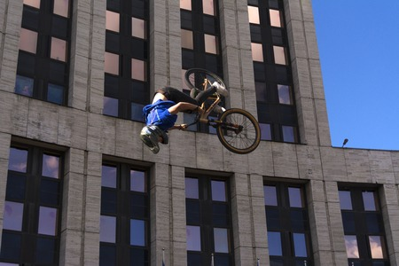 Moscow. Russia. 19 may 2019. Moscow Cycling festival 2019. The cyclist does the trick on the trampoline.