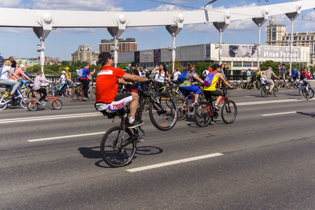 Moscow. Russia. 19 may 2019. Moscow Cycling festival Velofest 2019. Funny bike lovers go on the bridge. The cyclist does tricks. Editorial