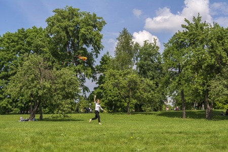 Moscow. Russia. 26 may 2019. The girl launches a kite in the Park