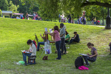 Moscow. Russia. 26 may 2019. Numerous artists paint in the summer Park Editorial