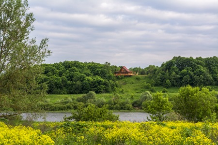 The house is located high above the river. In the foreground river valley in flowers. Imagens