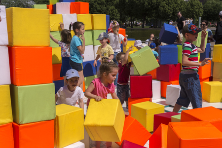 Moscow, Russia, 02 June 2019. Children build buildings of large blocks in the city Park Editorial