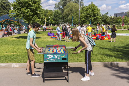 Moscow, Russia, 02 June 2019. Teenagers play table football in the city Park Editorial