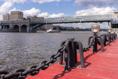 View of the Moscow river. River ship and bridge. The sharpness of the chain