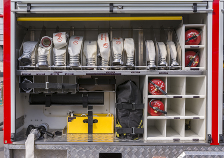 Moscow, Russia, 02 June 2019. Compartment in the fire truck with hoses, valves and fire extinguishers. Special Technical inscriptions in Russian