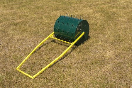 A special roller for the handling and laying of the lawn Фото со стока