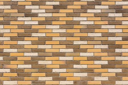The wall of the house is made of colorful decorative bricks.
