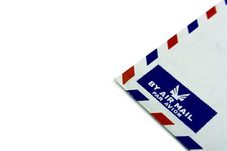 Corner of an old envelope with the airmail logo.