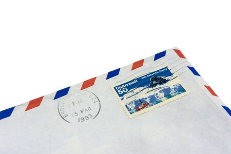 The corner of an old envelope with a redeemed stamp. Letter past US mail. Zdjęcie Seryjne