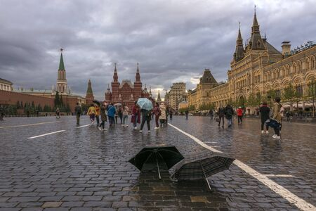Moscow, Russia. September 18, 2019. Red square in the rain. Two umbrellas stand on the cobblestones